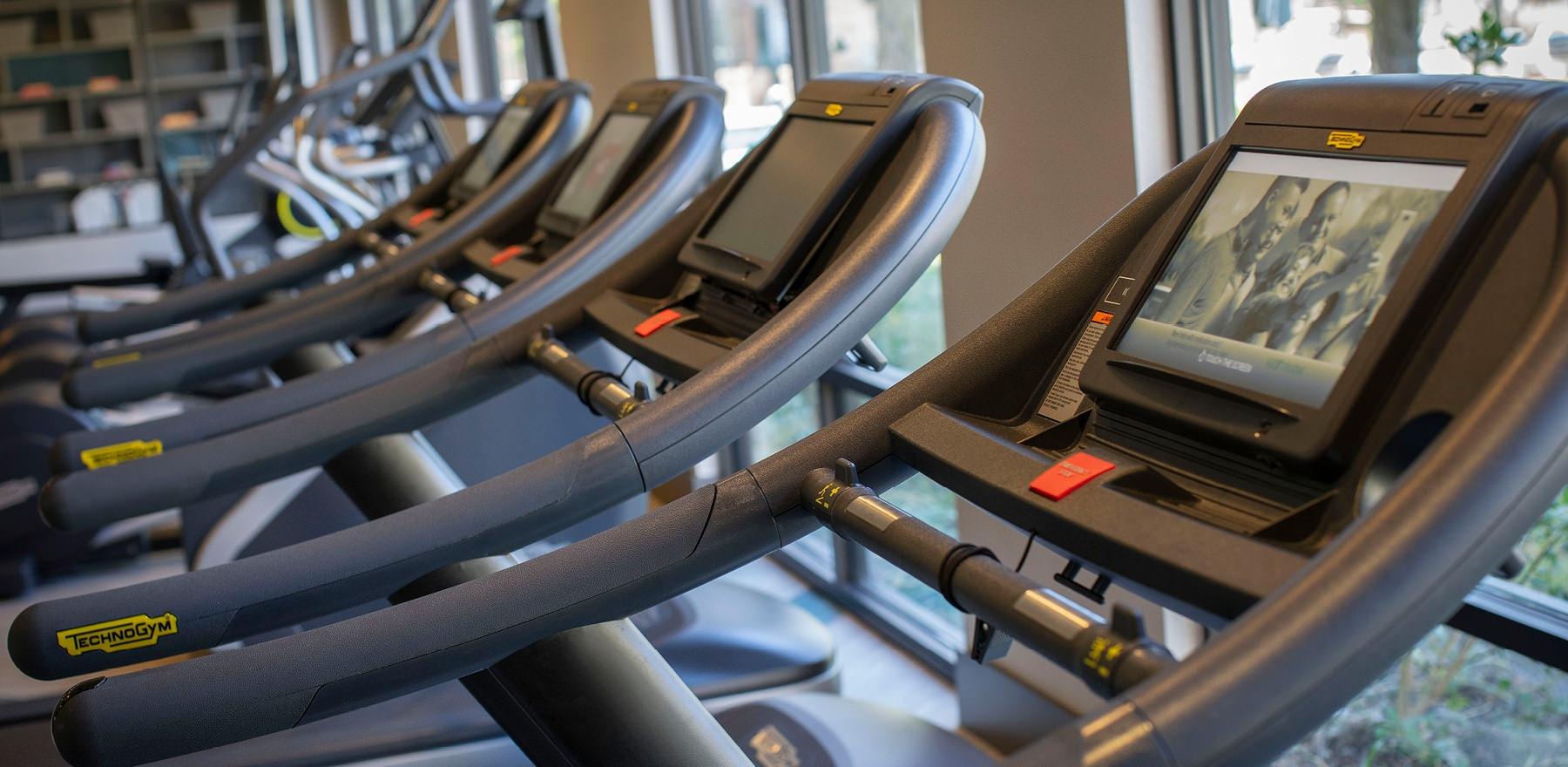 row of treadmills in fitness center