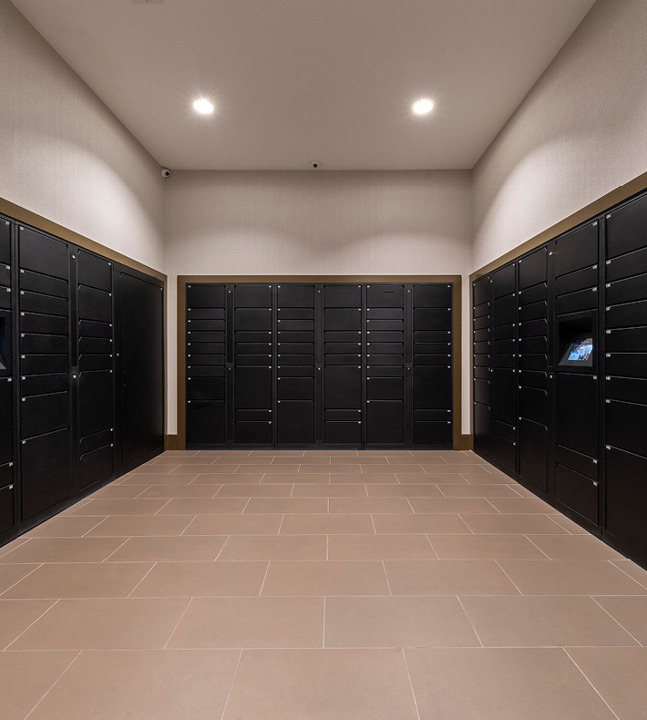 large, mail room with recessed lighting