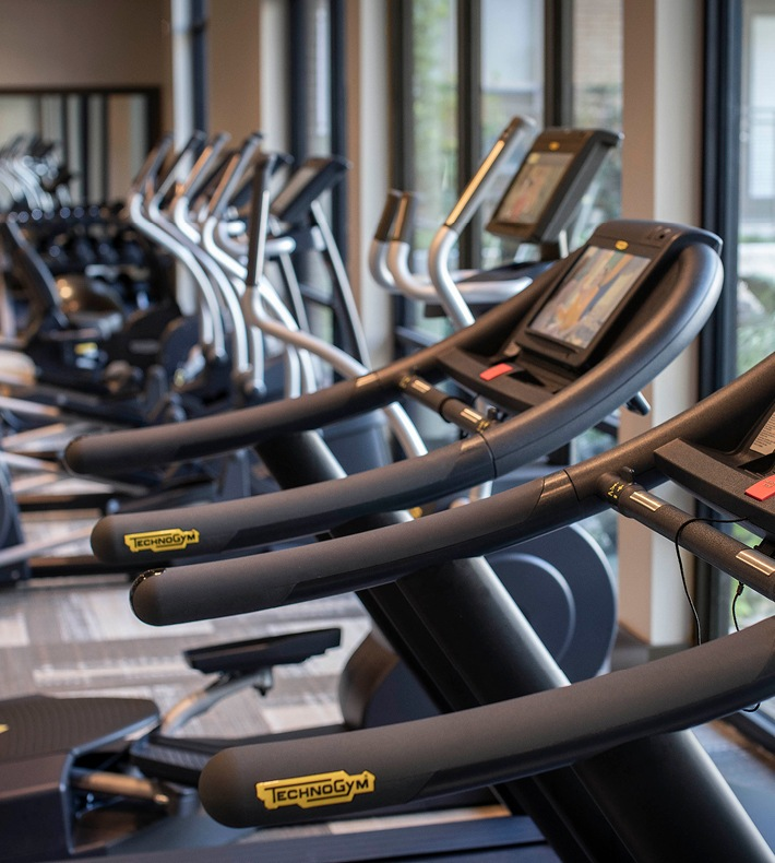 row of treadmills in fitness center